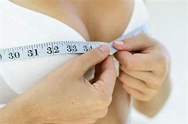 patient measuring breasts photo